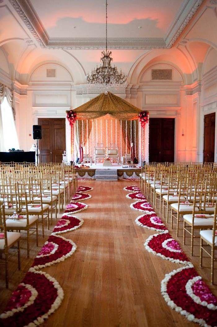 A beautiful wedding ceremony decor for a Valentine's Day wedding. Photo via South Asian Bride