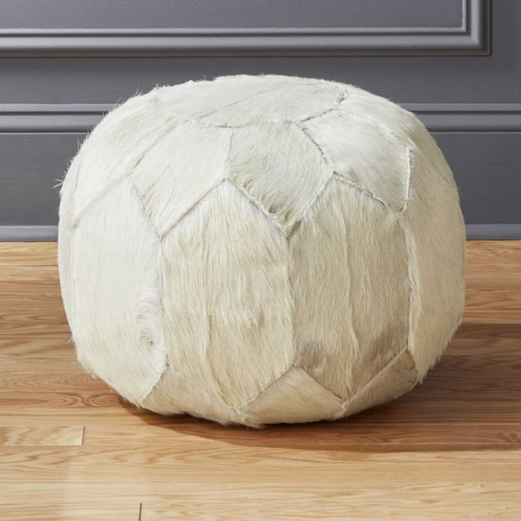 Shop White Hair on Hide Pouf.   Cowhide comes home in a patchwork Moroccan-style pouf.  Hair-on-hides naturally vary in color, tone and spotting, so each will be unique.