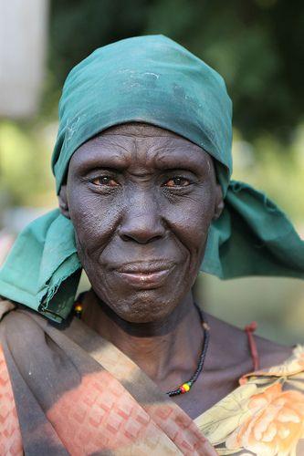 woman in green headwrap