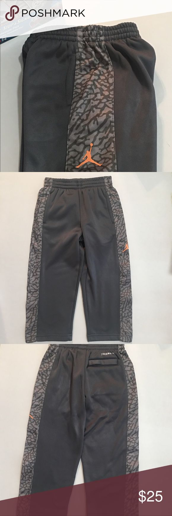 Nike Jordan Jumpman Boys Jogger Pants Therma Fit NWT! Nike Jumpman23/Jordan Jogger Pants: 2T & 3T. Therma Fit. 2-Front & 1-Back Pocket. Gray. Printed Side Panels. Made of: 100% Polyester. Nike Bottoms Sweatpants & Joggers