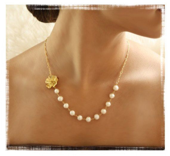 Wedding Freshwater Pearl Necklace with Gold Flower and Dangling Pearl Earrings Bridesmaid Set. $43.00, via Etsy.