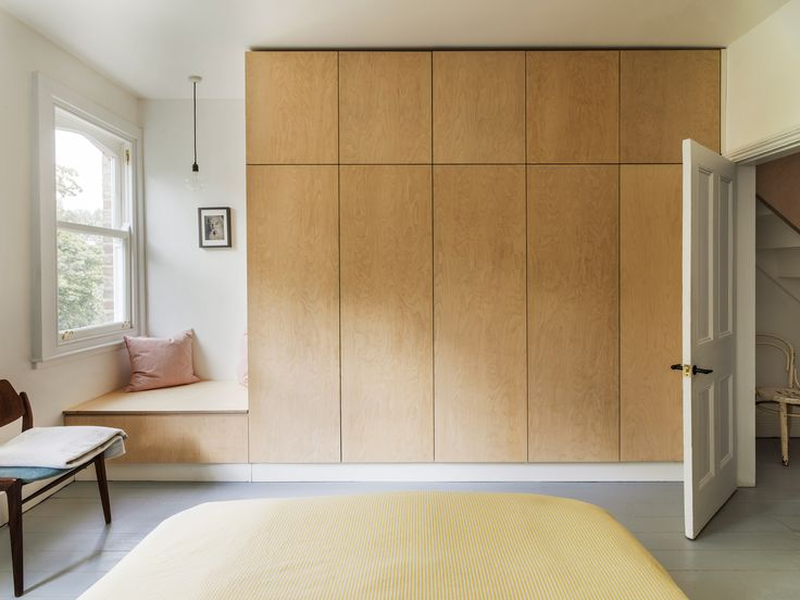 Built-in wardrobes in the bedroom and a new staircase leading to the attic were designed as a single element, interlocking through the central wall of the house.