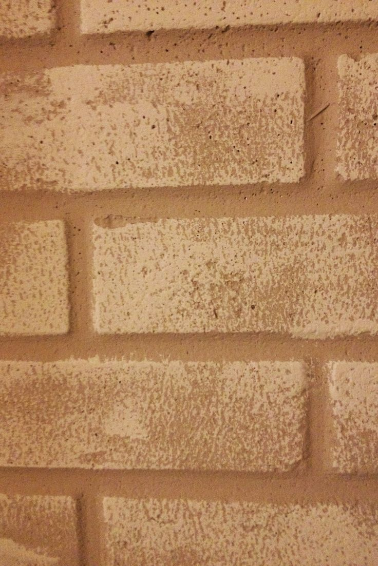 Quickly and easily add character to brick walls in a basement by lightly rolling a second color of paint on top. (Roll horizontally!)