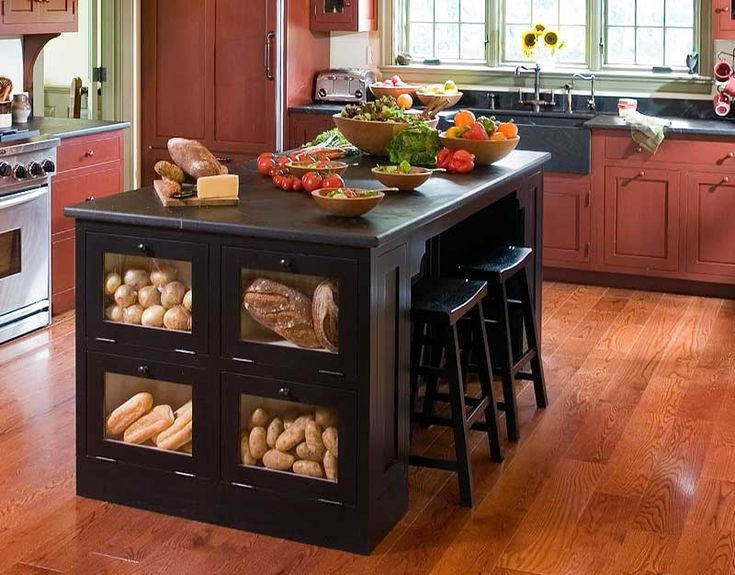 Like the bins -- http://www.cityhomeconstructions.com/wp-content/uploads/2012/06/Custom-Kitchen-Islands-With-Stools.jpg