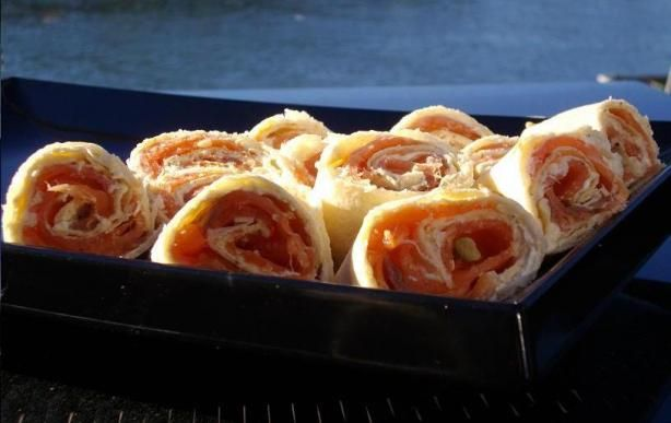 Roll ups: smoked salmon and cream cheese on sun-dried tomato tortilla ...
