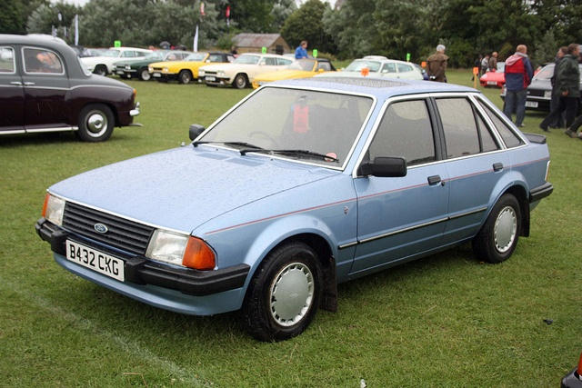 1985 Ford Escort 1.6 Ghia Mk3. Owned by us and several thousand other Brits - bland maybe, but incredibly successful. We liked it, but then sold it to buy a new Nissan Micra.