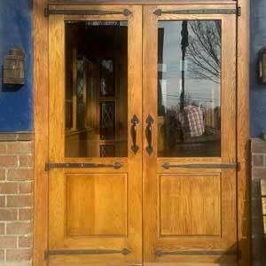 double entry door with custom hardware