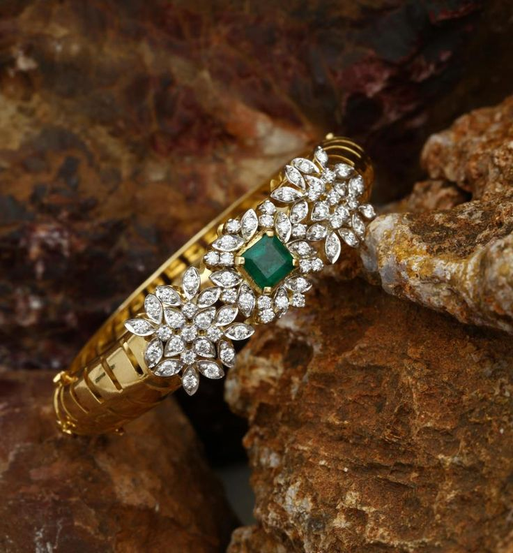 This amazing bracelet decked with diamonds and emerald exhibits tradition and class at the same time and would look perfect for every occasion from every facet. This piece of jewellery weights approximately 33.15 gms and diamonds of 2.42 carats.