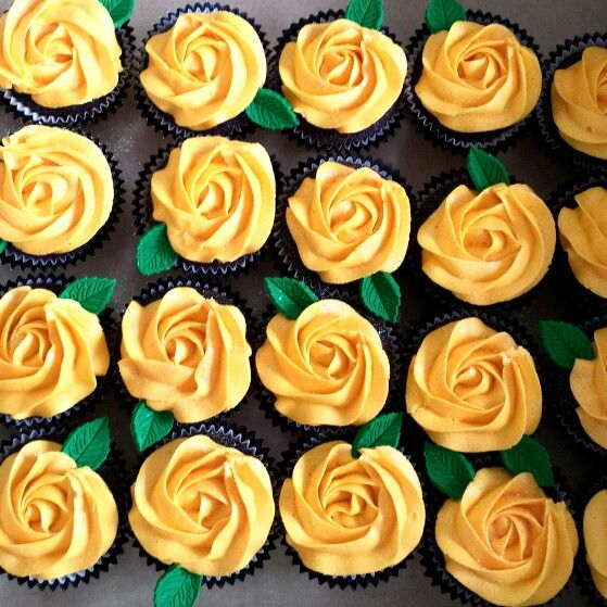 Chocolate cupcakes with yellow vanilla buttercream roses, fondant leaves & glitter