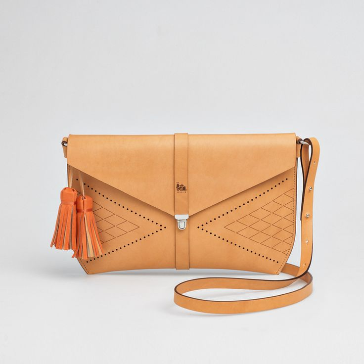 TheBétaVersion Zelda cross body bag in vegetable tanned leather with rust tassels and laser engraved pattern