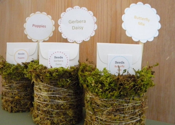 These moss-covered cans hold seed packets - cute favors for a shower or gifts for any gardener. via Homework
