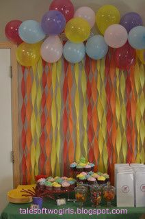 backdrop decorations with balloons and crepe paper