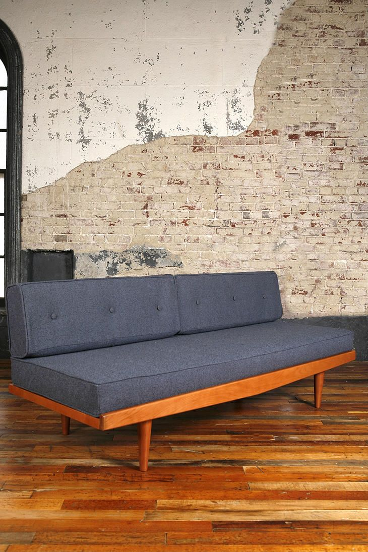 Inspired by vintage 1960s Danish modern daybeds. Clean, modern lines. Durable steel frame faced with rubberwood, a strong eco-friendly hardwood finished in a teak stain. Remove back cushions and support to convert sofa to a comfy twin-size bed. Covers are removable for easy cleaning. Simple assembly with removable legs to make moving a snap! $479