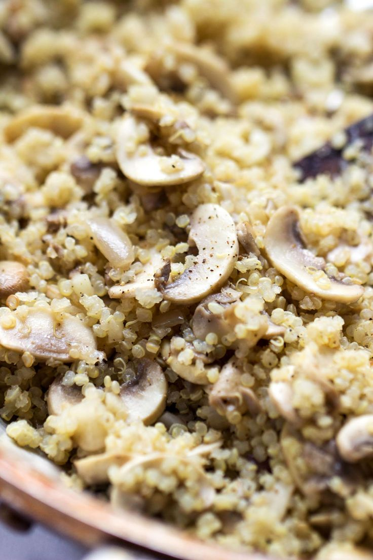This 10-MINUTE mushroom quinoa dish is flavored with garlic and herbs and makes for a perfect side dish to any type of meal!
