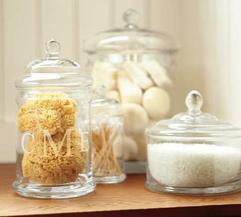 Guest bath: natural sponge and salts in apothecary jars for beachy feel.