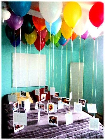 a way to ask him to prom! blow up balloons fill his room have some as pictures of us and others notes spelling out the question!!!!!!!!?