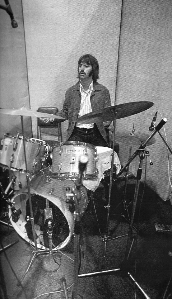 The Beatles' Abbey Road recording session, 1969: Ringo in the drum isolation area. Notice the trom fowel on the snare drum to deaden the sound. It is said that some of Ringo's best work was on these sessions. All text on Abbey Rd pics from https://blackjacketsymphony.wordpress.com/2013/05/09/abbey-road-in-the-studio-not-the-street/