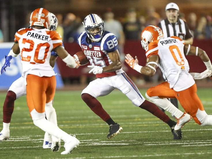 Week 3 - July 6 2017 - BC.23 - MTL.16 - Montreal Alouettes #85 B.J. Cunningham is pursued by British Columbia Lions Keynan Parker and Loucheiz Purifoy during punt return in second half of Canadian Football League game in Montreal Thursday July 6, 2017.  JOHN MAHONEY/MONTREAL GAZETTE