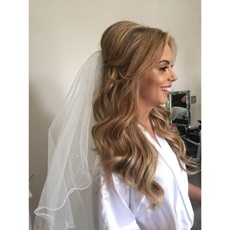 Bridal hair half up with veil