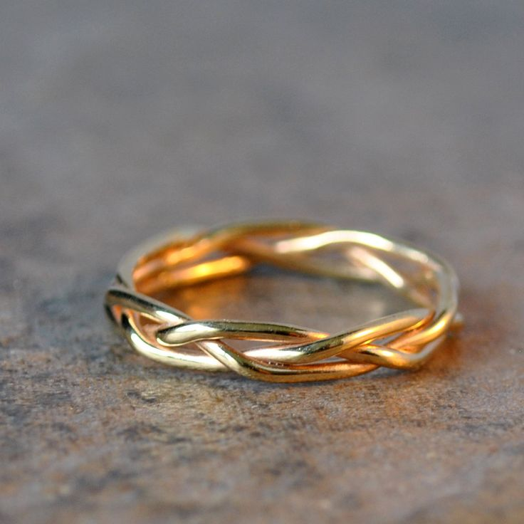 14k solid gold hand braided ring - wedding band, anniversary band. via Etsy.