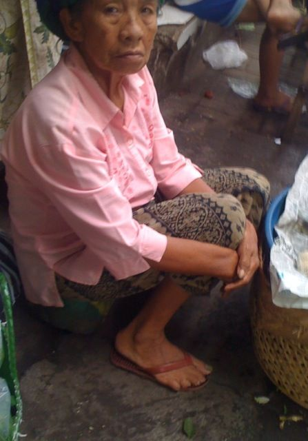 The prettiest pink shirt in the market today. Ubud Market Bali early morning.