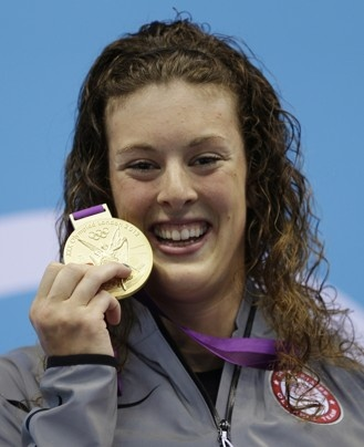 United States' Allison Schmitt poses with her gold medal for the women's 200-meter freestyle swimming final .