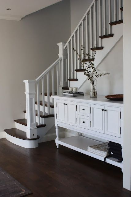 solid color banister, knob replacement, dark stained or black painted stair steps to match floor panels
