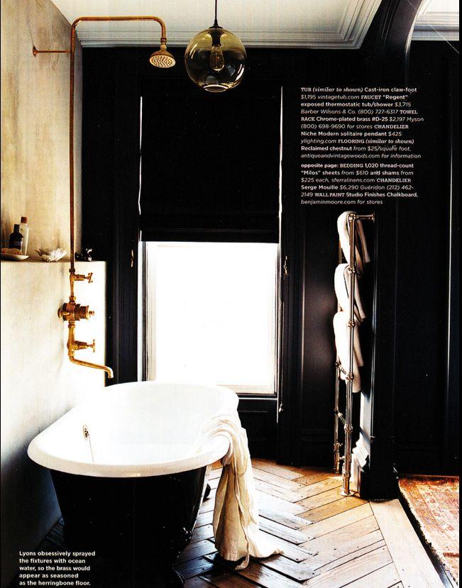 BATHROOM: Freestanding tub, parquet floors, dark walls, brass tapware.