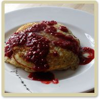 30 PCOS Friendly Breakfast ideas like these Almond Pancakes with Raspberry Sauce in the PCOS Diva Summer Meal Plan.