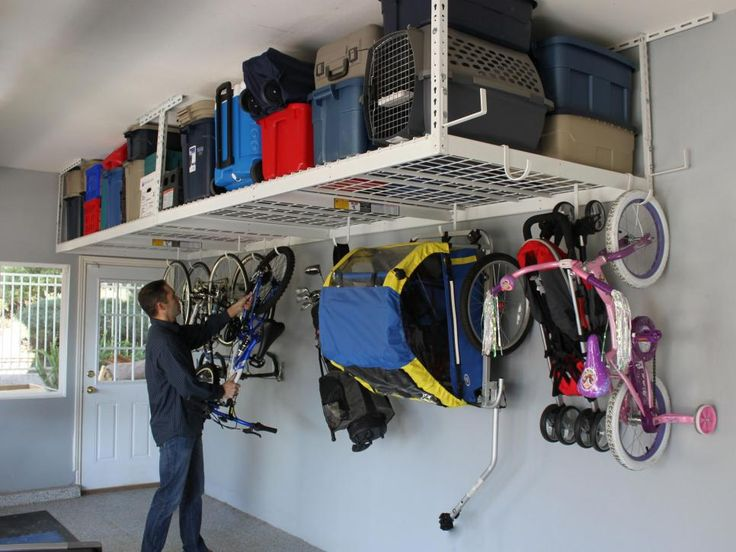 Get your garage back by hoisting large items overhead. Available in nine sizes, the SafeRacks heavy-duty overhead storage system can handle up to 600 pounds' worth of bicycles, ladders, and other gear. Choose from three types of accessory hooks: deck hooks, rail hooks, and sport utility hooks. Photo courtesy of SafeRacks