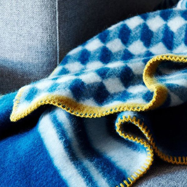 The Arv blanket's design is inspired by a time honored pattern from the Norwegian hand weaving tradition, interpreted in a modern idiom of geometric forms.