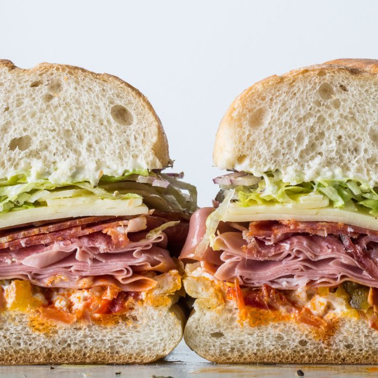 Visit an Italian deli and splurge on the cold cuts, but hit the supermarket for everything else, including the not-too-crusty rolls that are usually loaded into bins in the bakery section.