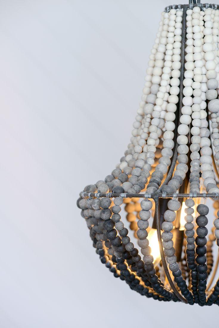 Beatiful hand rolled clay bead chandelier. Alix Helps Interiors.