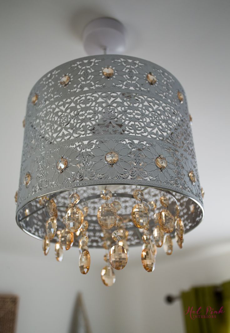 The ceiling pendant, with its intricate cut out design, hanging acrylic beads and amber, crystal droplets compliment the level of detail so often seen in Asia and cast gorgeous, patterned shadows on the walls to create a warm, cosy atmosphere.  Sourced from - @therange   https://www.therange.co.uk/ceiling-lights/pendants/flower-amber-crystal-pendant#937867