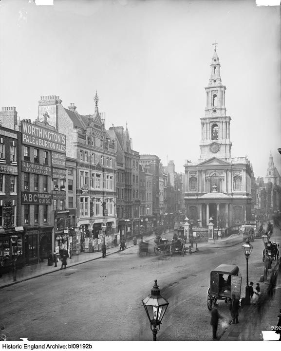BL09192B Street scene looking north-east along the Strand towards the church of St Mary-le Strand, with Cloveridge's Restaurant to the left, and the tower of St Clement Danes visible in the background. St Mary-Le-Strand Church, Strand, Strand, Greater London Authority, WC2. 29 Apr 1889, Bedford Lemere and Company.