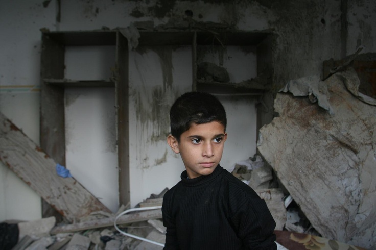 Hussam, 11, surveys the remnants of his damaged home, in the city of Rafah, in the Gaza Strip.  ---  Children throughout the region struggle to cope after the violence. UNICEF and its partners are working hard on emergency projects to get children back to class, despite damage to more than 136 schools and kindergartens. We're also providing health services, water, sanitation and psychosocial support to children.     © UNICEF/2012/Iyad El Baba     http://www.unicef.org