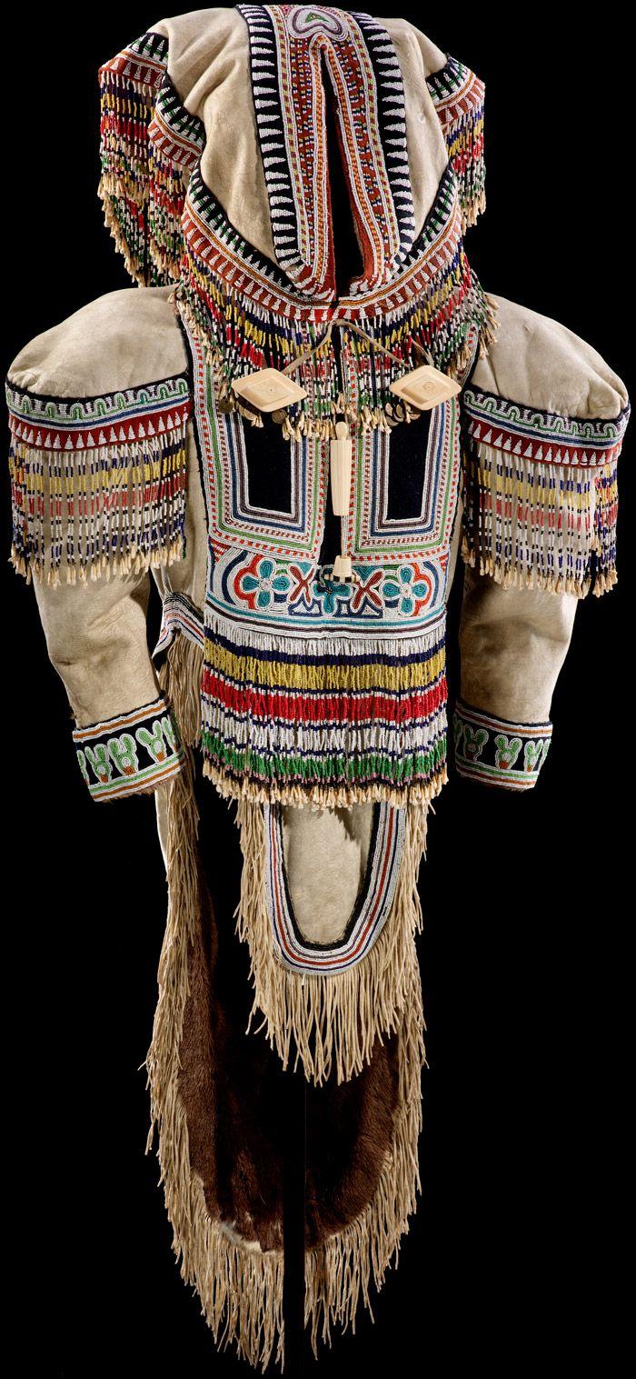 Inuit amauti or tuilli (woman's parka) ca. 1890–1925 Iqluligaarjuk (Chesterfield Inlet), Nunavut, Canada Parka: caribou skin, glass beads, stroud cloth, caribou teeth, and metal pendants