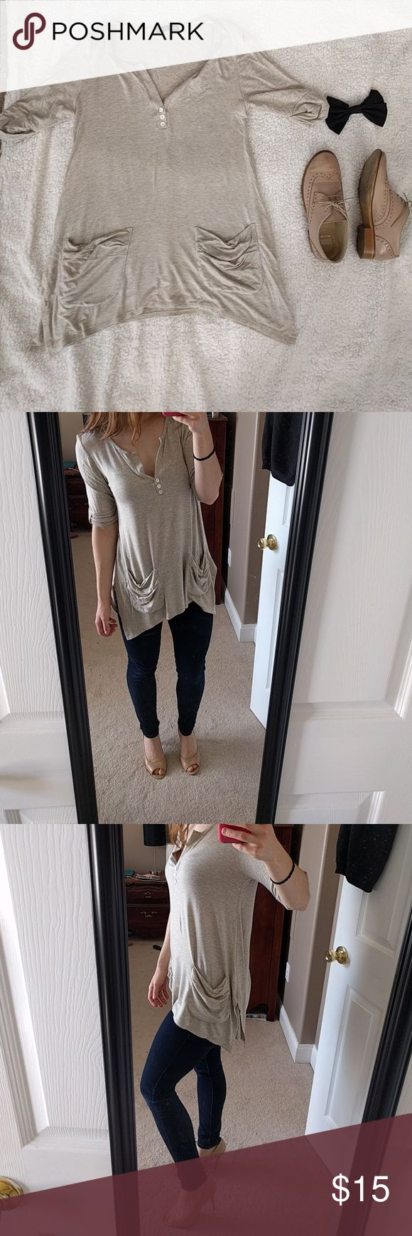 Nude slouchy tunic This top is an essential for your wardrobe! Goes with almost any style, and the slouchy pockets are the perfect touch. Worn only once or twice, and in perfect condition! The added slits and slight sharkbite-hem make it dressy enough to either dress up with some heels or down with some jeans and slip ons. Tops Tunics