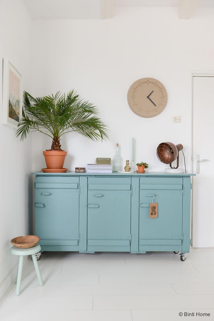 Closet, wall clock, plant, lamp.