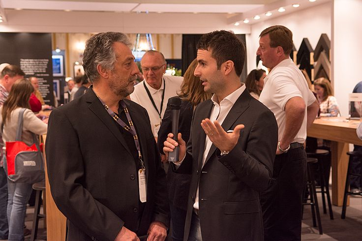 Decor's Michael Pacitti and Roma Moulding CEO, Tony Gareri chatting at #WCAF15 #ChoosePowerfully
