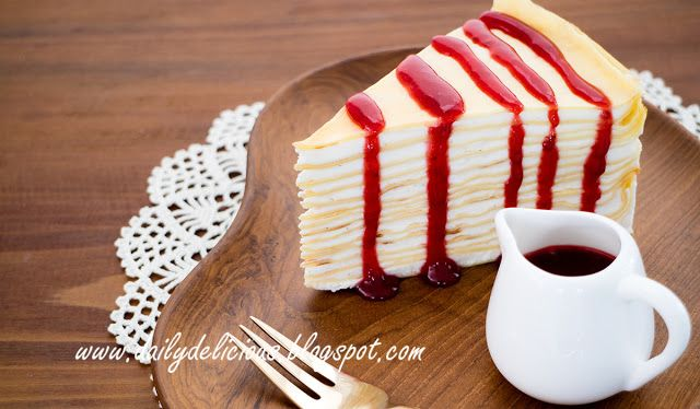 dailydelicious: Crepe cake with berry sauce