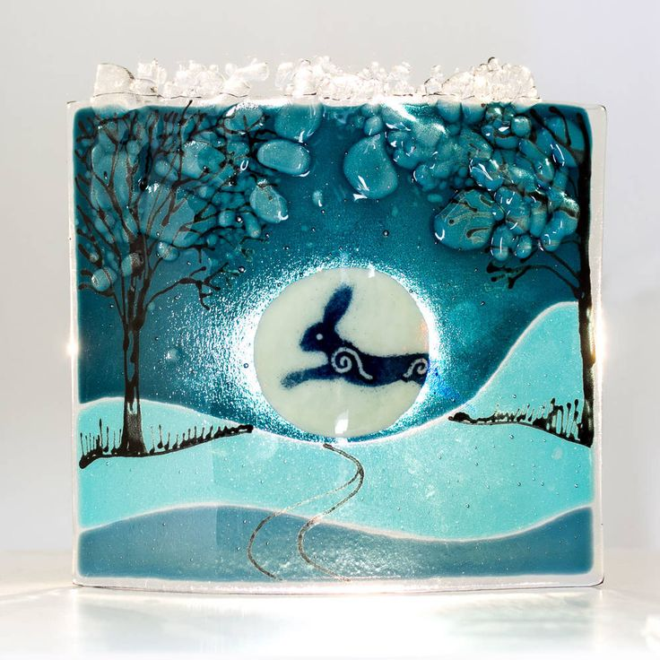 Helen Grierson: A beautiful curved, fused piece of glass the depicts the Luna Hare jumping  across the nighttime moon. Folklore tales of witches drinking the juice of  the harebells, turning themselves into hares to travel across the  Northumbrian countryside unnoticed.  These look gorgeous lit from behind, e