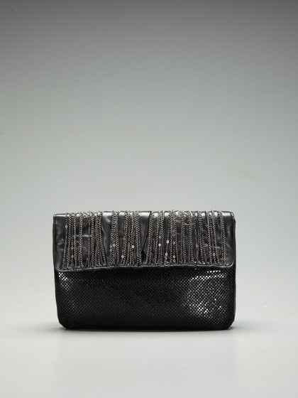 edgy but chic and unique? ...yes, please.  - - - - - - - - - - -   Mcqueen Convertible Clutch by Whiting & Davis on Gilt.com