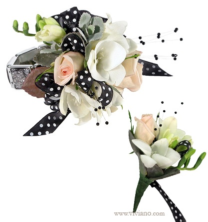 Make her the center of attention! 'Spotlight' prom corsage in black, white, and blush with freesia, spray roses, echeveria succulent, polka-dotted ribbon, and bead sprays on the black Fire-N-Ice bracelet. Shown with the matching boutonniere. #VivianoFlowerShop