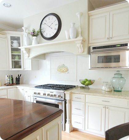 10 Lessons on Building a Kitchen - love the look of the shelf and clock over the stove
