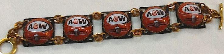 If you are from Michigan, you know that A&W is the only real root beer.  There is no other!  If you're not from Michigan - you have to try some A&W root beer; seriously, it's that good!   This adorable one-of-a- kind chain link bracelet is artisan made in Michigan from recycled A&W bottle tops. It's a unique, literally one of a kind, and a stylish gift for any true root beer lover! A&W Chain Link Bracelet – Our Greentopia