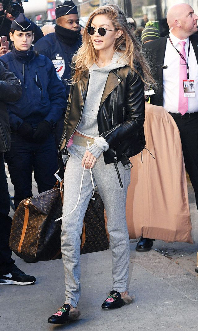 On Gigi Hadid:Oliver Peoples The Row After Midnight Sunglasses($450); Amiri Shotgun Cropped Hoodie in Grey($790); Nour Hammour leather jacket; Louis Vuitton Keepall 55...
