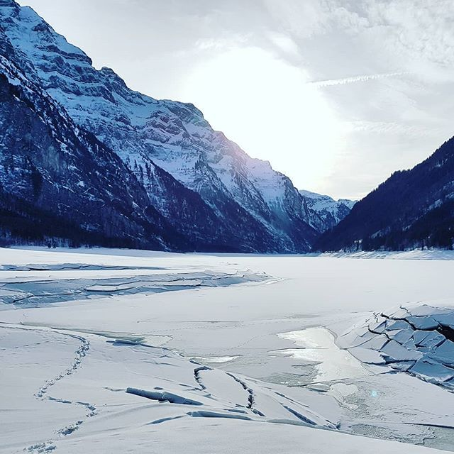 Dry frozen lake.  What a nice day!  #switzerland #ice #snow #berg #mountains #naturelovers #nature #landscape #lake