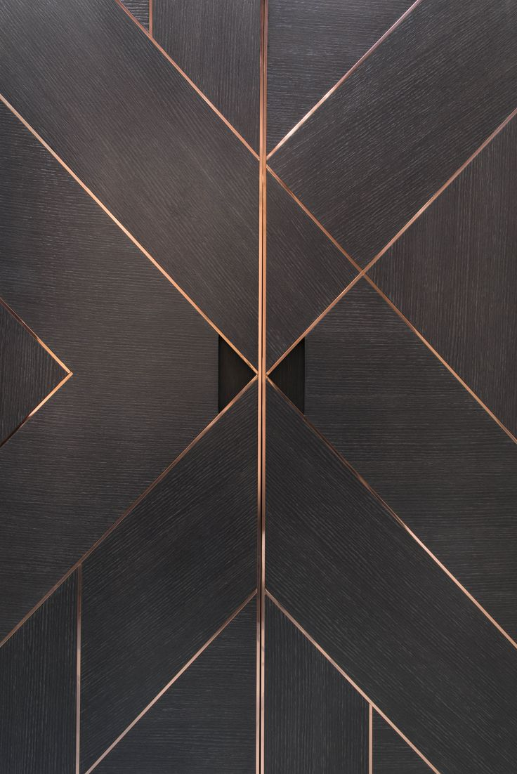 Geometric brass details in the dyed sycamore bar.