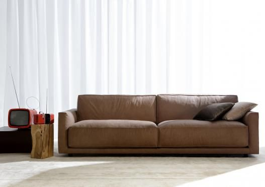 "Fashionable and precious, Ribot the modern leather "" sofa"" above all: seat cushions comfortable and always perfect, high back that sustains and receives, pinched seams (""paperina"") that sketch the outlines and exalt the volumes as a dress of haute couture dress-maker's."